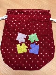 LaceyMays Haberdashery Dolly Bag Jigsaw pieces on red